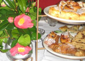 Food and flowers on a serving table at the cafe