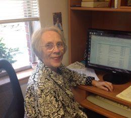 Carlye Teel a desk